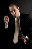 Adult businessman well-dressed serious sitting Stock Photo
