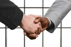 Adult businessmen shake hands. Royalty Free Stock Image