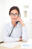 Adult businesswoman conversing on the phone Stock Photography