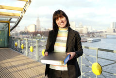 Adult businesswoman with documents. On the bridge stock image