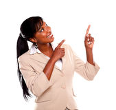 Adult businesswoman looking and pointing up Stock Images