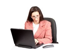 Adult Businesswoman woking on laptop Royalty Free Stock Photos