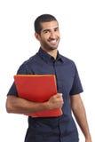 Adult casual arab man student posing standing holding folders stock photo