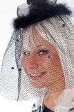 Adult Caucasian Female in Black Veil. An Adult Caucasian Female with silvery, white hair in a black veil with purple, felt dots Royalty Free Stock Image