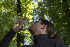 Adult caucasian man drinking water outdoors Stock Photography