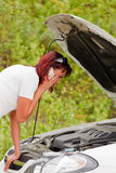 Adult caucasian woman and her car Royalty Free Stock Image