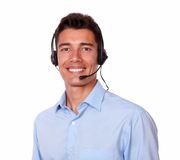 Adult charismatic man with headphones smiling Stock Photos