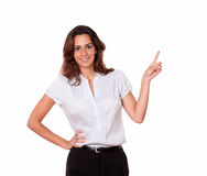 Adult charismatic young woman pointing and smiling Royalty Free Stock Photography