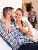 Adult and cheating partner at home Stock Image