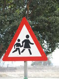 Adult and Child Crossing Sign. Post for a school Royalty Free Stock Image