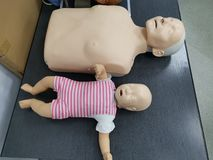 Adult and child resuscitation mannequin royalty free stock photography