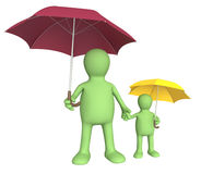 Adult and child with umbrellas Royalty Free Stock Images