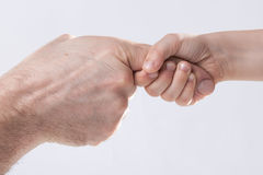 Adult and child's hand touching help tenderness Royalty Free Stock Photography