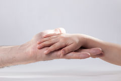 Adult and child's hand touching help tenderness Stock Photo