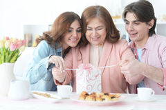 Adult children congratulate the elderly mother Royalty Free Stock Photo