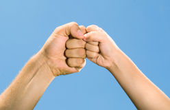 Adult and children's hands against the blue sky Stock Image