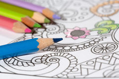 Adult coloring book and colorful pencils. Royalty Free Stock Photo