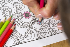 Adult coloring book and colorful pencils. Royalty Free Stock Photography