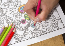 Adult coloring book and colorful pencils. Royalty Free Stock Photos