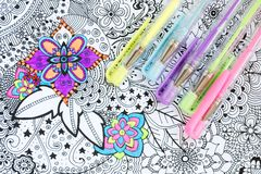 Adult coloring book, new stress relieving trend. Art therapy, mental health, creativity and mindfulness concept. Adult coloring. Adult coloring book, new stress royalty free stock photos