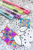 Adult coloring book, new stress relieving trend. Art therapy, mental health, creativity and mindfulness concept. Adult coloring. Adult coloring book, new stress stock photography