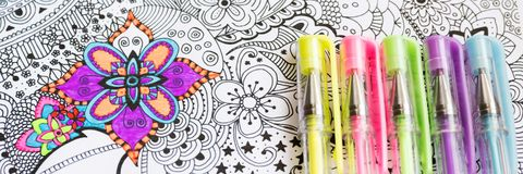 Adult coloring book, new stress relieving trend. Art therapy, mental health, creativity and mindfulness concept. Web banner, panoramic close up shot Stock Image