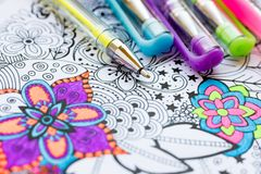 Adult coloring book, new stress relieving trend. Art therapy, mental health, creativity and mindfulness concept. Adult coloring page with pastel colored gel royalty free stock images