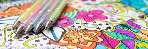 Adult coloring book, new stress relieving trend. Art therapy, mental health, creativity and mindfulness concept. Web banner. stock images