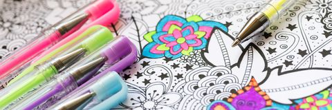 Adult coloring book, new stress relieving trend. Art therapy, mental health, creativity and mindfulness concept. Web banner. Adult coloring book, new stress stock photos