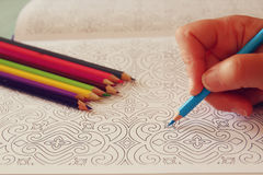 Adult coloring book trend, for stress relief. top view. Royalty Free Stock Photography