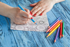 Adult coloring books colored pencils anti-stress tendency Royalty Free Stock Image