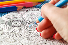 Adult coloring books colored pencils anti-stress tendency Stock Photo