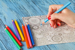 Adult coloring books colored pencils anti-stress tendency Stock Photos