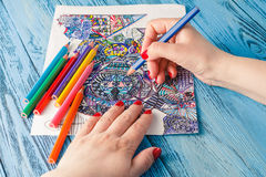 Adult coloring books colored pencils anti-stress tendency. Hobbi. Es woman's hands painting stress relief painter stock photos