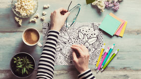 Adult coloring books, mindfulness concept. Adult coloring books, new stress relieving trend royalty free stock image