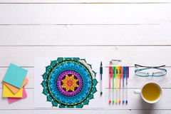 Adult coloring books, mindfulness concept. Adult coloring books, new stress relieving trend Stock Photos