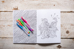 Adult coloring books, new stress relieving trend. Mindfulness concept stock photo