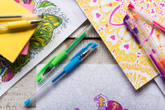Adult coloring books, new stress relieving trend. Adult coloring books, stress relieving trend, mindfulness concept stock image
