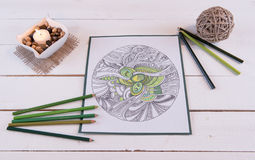 Adult Coloring Page Fresh Greens. Adult coloring page scene on white plank background stock photo