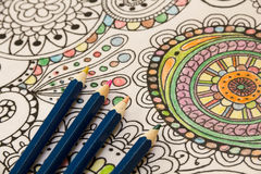 Adult colouring books with pencils, new stress relieving trend, mindfulness concept person coloring illustrative Royalty Free Stock Images