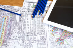 Adult colouring books with  pencils, new stress relieving trend, mindfulness concept person coloring  illustrative Royalty Free Stock Photo