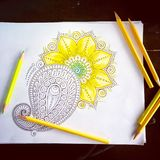 Adult Colouring. Colouring of a mandala with yellow and various shading stock photography