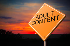 Adult Content on Warning Road Sign. Royalty Free Stock Image