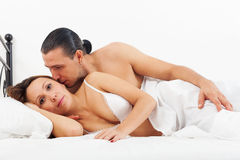 Adult couple awaking together Royalty Free Stock Photography