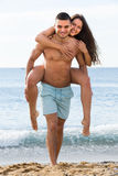 Adult couple on the beach Royalty Free Stock Image