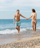 Adult couple on the beach Stock Image