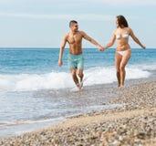 Adult couple on the beach Stock Photo