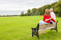 Adult couple on the bench Stock Photography