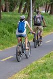 Adult couple biking together on the bike road in Hungary stock photography