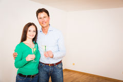 Adult Couple Celebrating Their New Apartment Stock Images